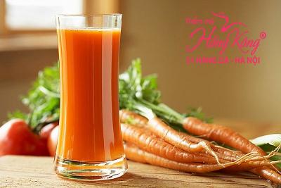 Mật ong + nước ép cà rốt có tấc dụng xóa nhăn khóe miệng